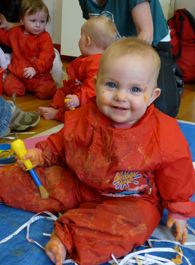 Baby enjoying creative play  at The Creation Station Baby Discovery class